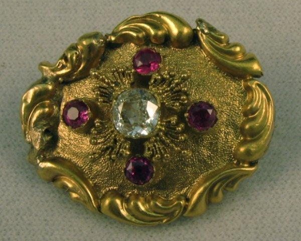 605: RUBY, DIAMOND AND FOURTEEN KARAT GOLD BROOCH,  set