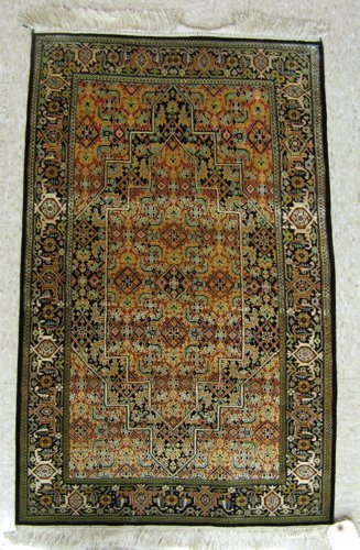 12: FINE SILK AREA RUG, hand knotted in an overall  Her