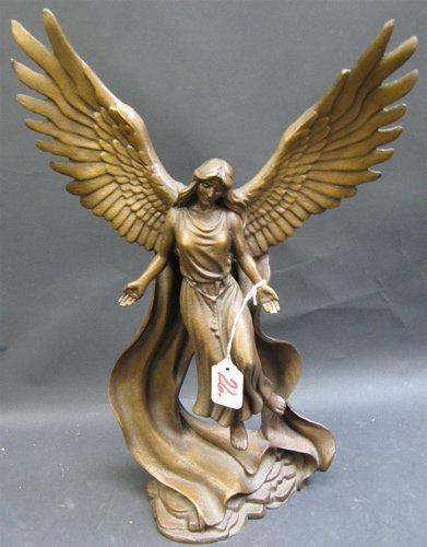26: A HEAVY CAST IRON STATUE of a guardian angel  havin