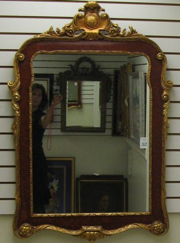 312: A DECORATIVE FRENCH STYLE WALL MIRROR, the gilt  a
