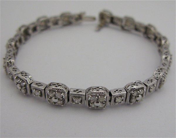 613: DIAMOND AND 14 KARAT WHITE GOLD BRACELET, 7  inche