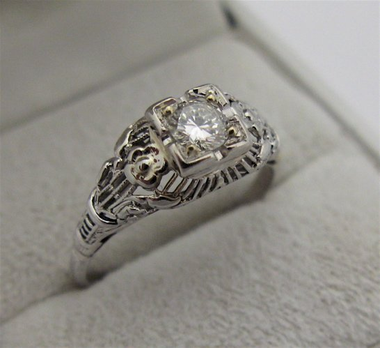 614: DIAMOND AND 14 KARAT WHITE GOLD SOLITAIRE RING,  c