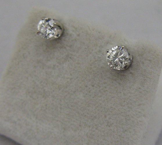 625: PAIR OF DIAMOND AND 14 KARAT WHITE GOLD EAR  STUDS