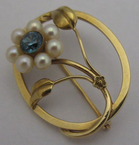 321: ZIRCON, PEARL AND 14K GOLD FLORAL BROOCH, oval in