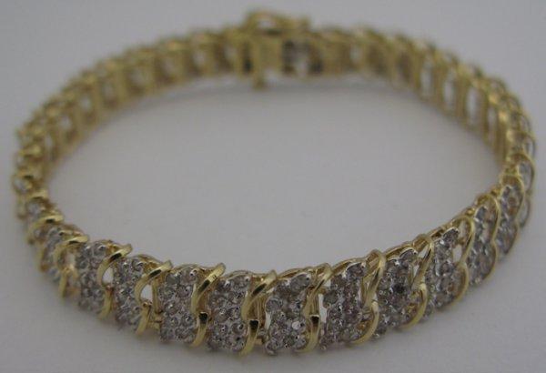 "322: DIAMOND AND 10K GOLD BRACELET, 7-1/4"" in length  a"