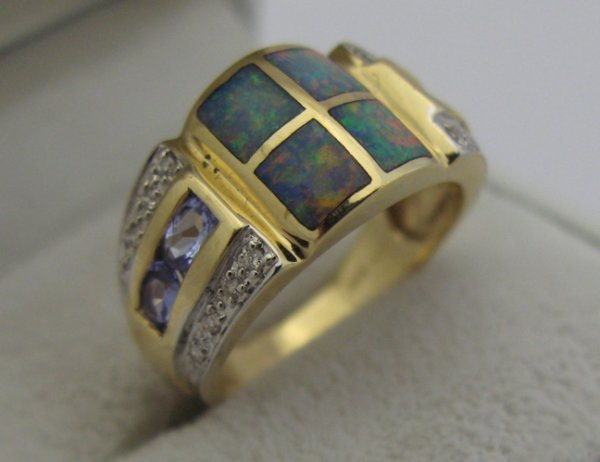 504: OPAL, DIAMOND AND 14K GOLD RING, set with four  ta