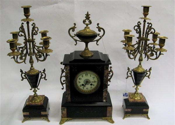 621: THREE PIECE AMERICAN CLOCK SET. The center clock w