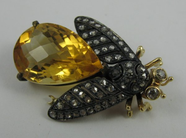 523: CITRINE, DIAMOND, SILVER AND 14K GOLD BROOCH,  set