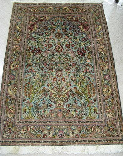 12: PERSIAN QUM PRAYER RUG, hand knotted in a vase  of