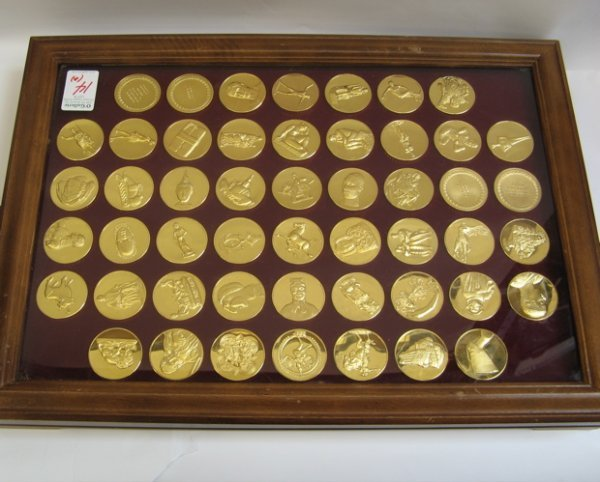14: A COLLECTION OF FIFTY GOLD ON BRONZE MEDALS  titled
