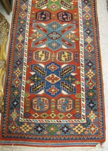 20: TURKISH RUNNER, hand knotted in an overall  geometr