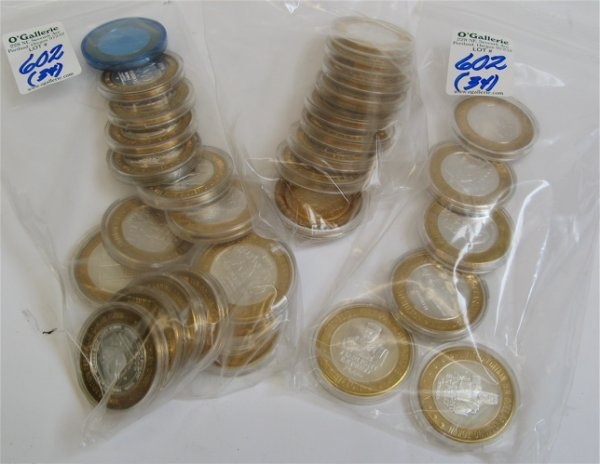 602: THIRTY-FOUR .999 SILVER GAMING TOKENS in $10  deno
