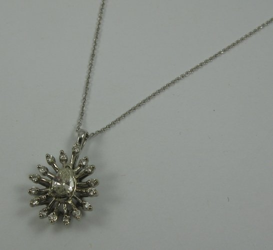 626: DIAMOND AND 14K WHITE GOLD PENDANT NECKLACE. The p