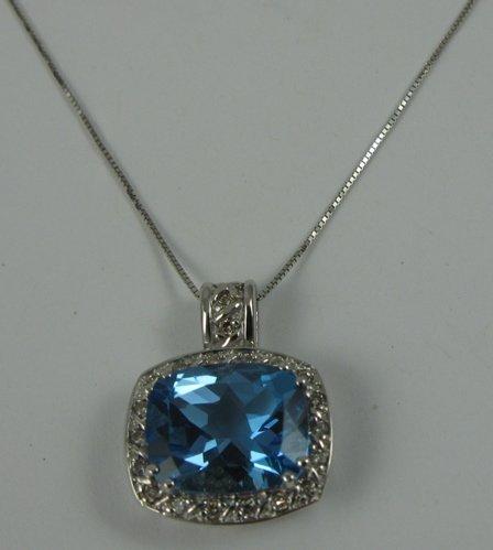 627: BLUE TOPAZ, DIAMOND AND WHITE GOLD PENDANT  NECKLA