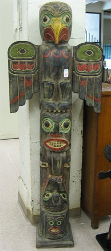 31: CARVED AND PAINTED WOOD TOTEM POLE, featuring  thre