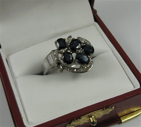 322: SAPPHIRE, DIAMOND AND 18K WHITE GOLD RING, with  a
