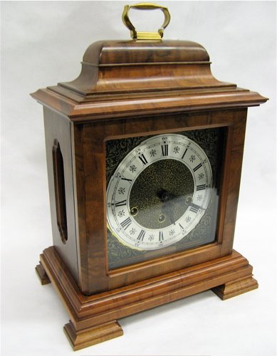 602: GERMAN MADE MANTEL/SHELF CLOCK. The burled  hardwo