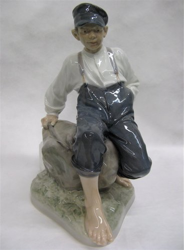 "603: ROYAL COPENHAGEN FIGURE, ""BOY ON STONE"", #1659.  B"