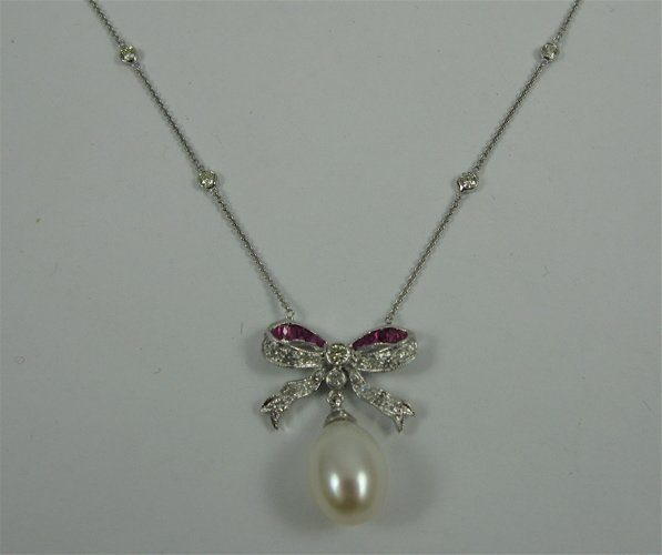 613: PEARL, RUBY AND 18K WHITE GOLD NECKLACE, with an o