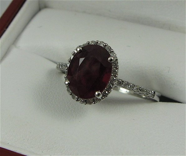 614: RUBY, DIAMOND AND 14K WHITE GOLD RING, with  appra
