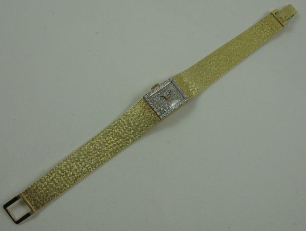 1002: DIAMOND AND 14 KARAT GOLD BRACELET  WRISTWATCH