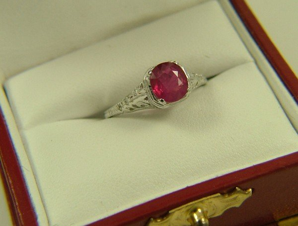 1024: RUBY SOLITAIRE RING, 14K white gold filigree  set