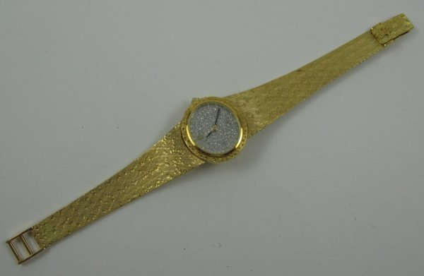 1147: LADY'S DIAMOND & 18 KARAT GOLD WRISTWATCH