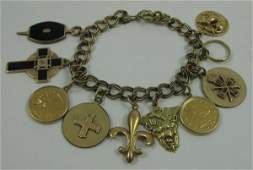 "183: YELLOW GOLD CHARM BRACELET, 7-1/2"" in length.  The"