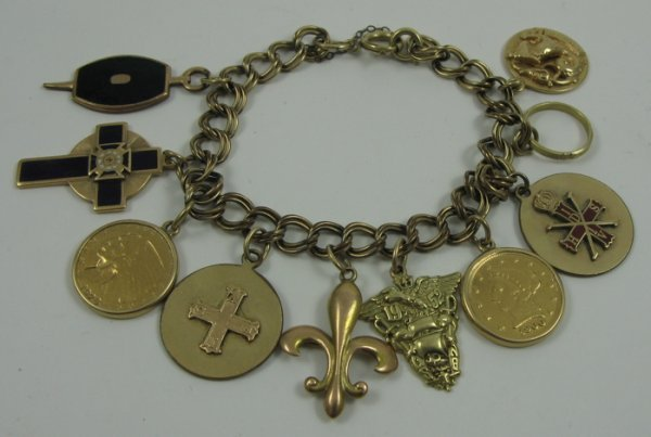 """183: YELLOW GOLD CHARM BRACELET, 7-1/2"""" in length.  The"""