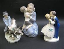 488: THREE DANISH GLAZED PORCELAIN FIGURAL GROUPS.