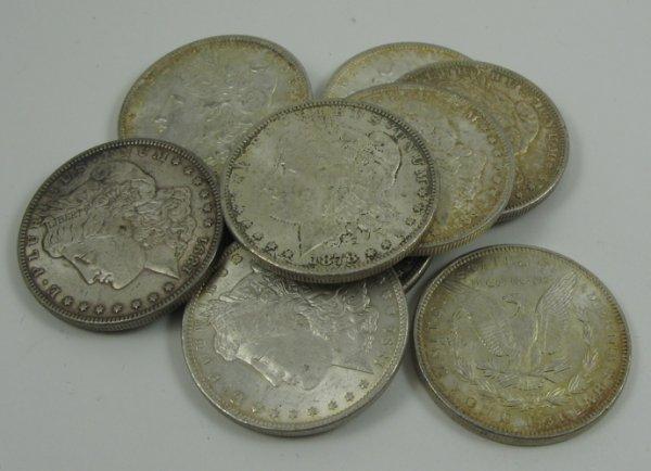 601: NINE U.S. CARSON CITY SILVER DOLLARS