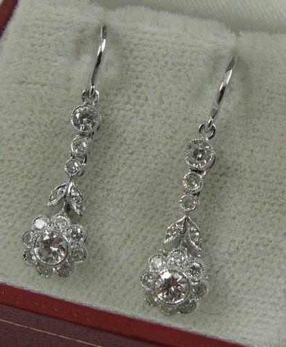 613: PAIR OF DIAMOND AND EIGHTEEN KARAT GOLD  EARRINGS,