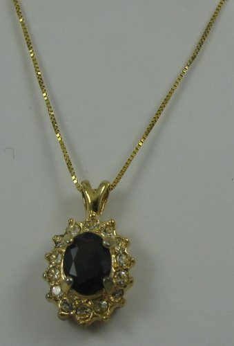 626: GARNET AND YELLOW GOLD PENDANT NECKLACE. The 10k g
