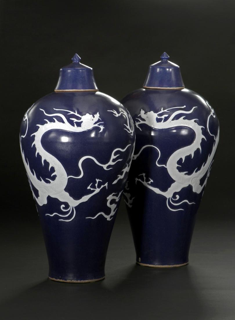 Pair Blue Enameled White Reserved Dragon Vases