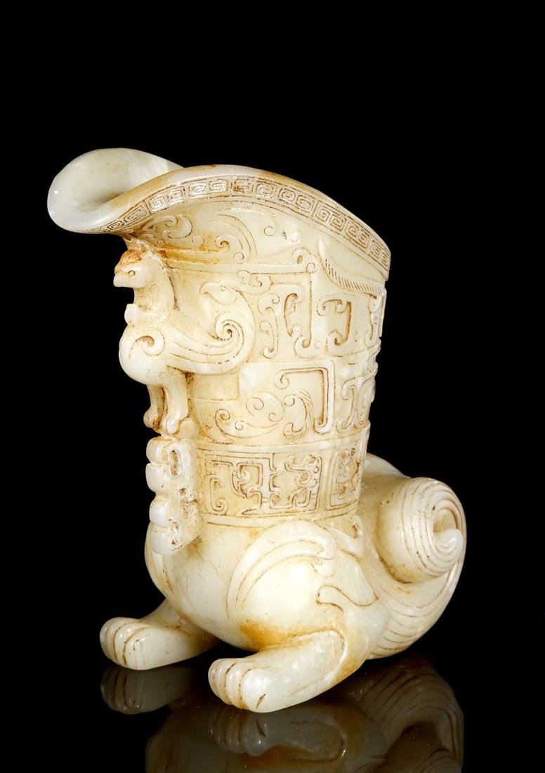Chinese Celadon and Russet Archaistic Jade Rhyton