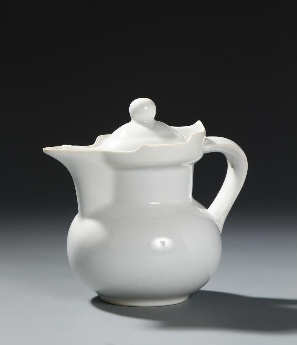 Chinese White-Glazed 'Monk's Cap' Ewer and Cover