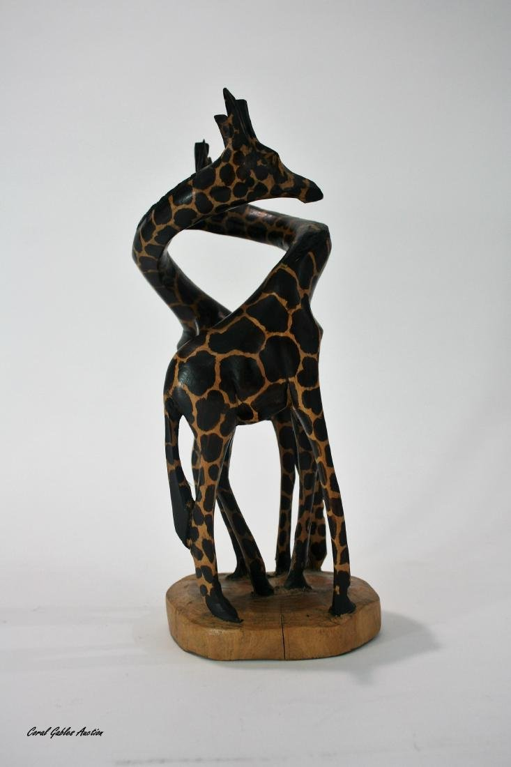 Carved wood giraffe pair