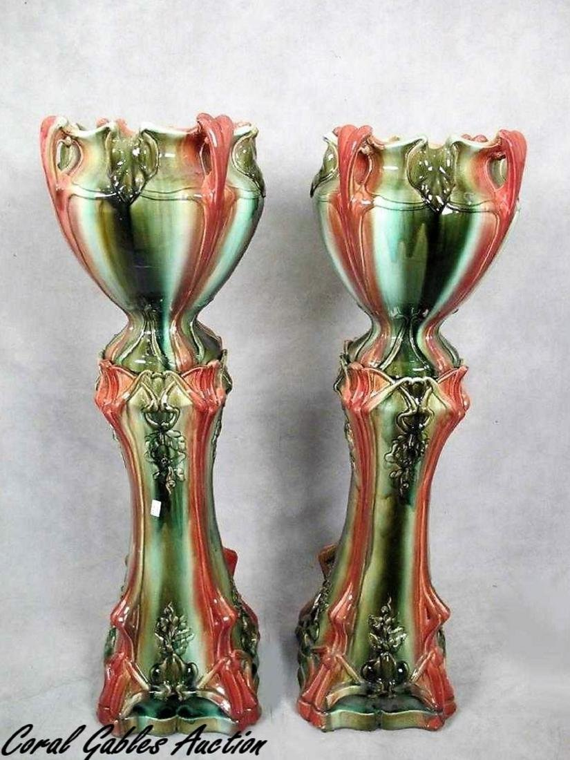 Pair of Continental majolica jardinieres with stand