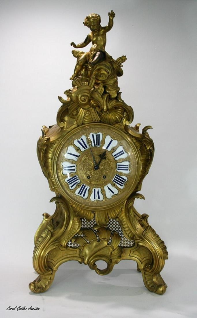 Very large A Louis XV style gilt bronze mantel clock 19