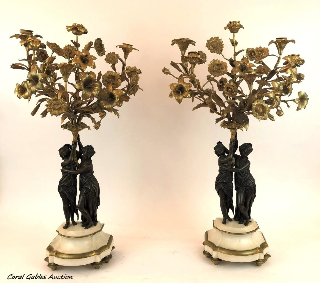 Antique pair of bronze chandeliers with marble base.