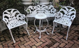 Four Piece Wrought Iron Patio Furniture Set