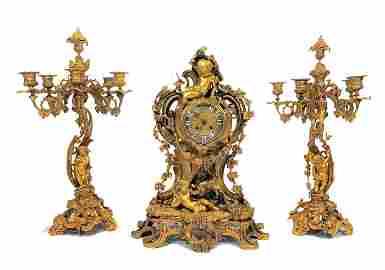 A beautiful gilt bronze garniture style Louis XV