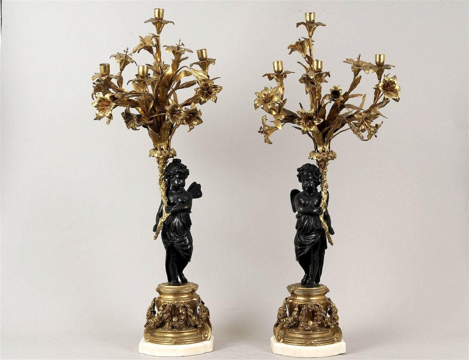 PAIR OF PATINATED AND GILT BRONZE FIGURAL FOUR LIGHT CA