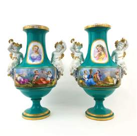 Pair of sevre style vases with designs in biscuit