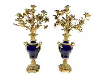 Pair of French Bronze and Porcelain Candelabras.