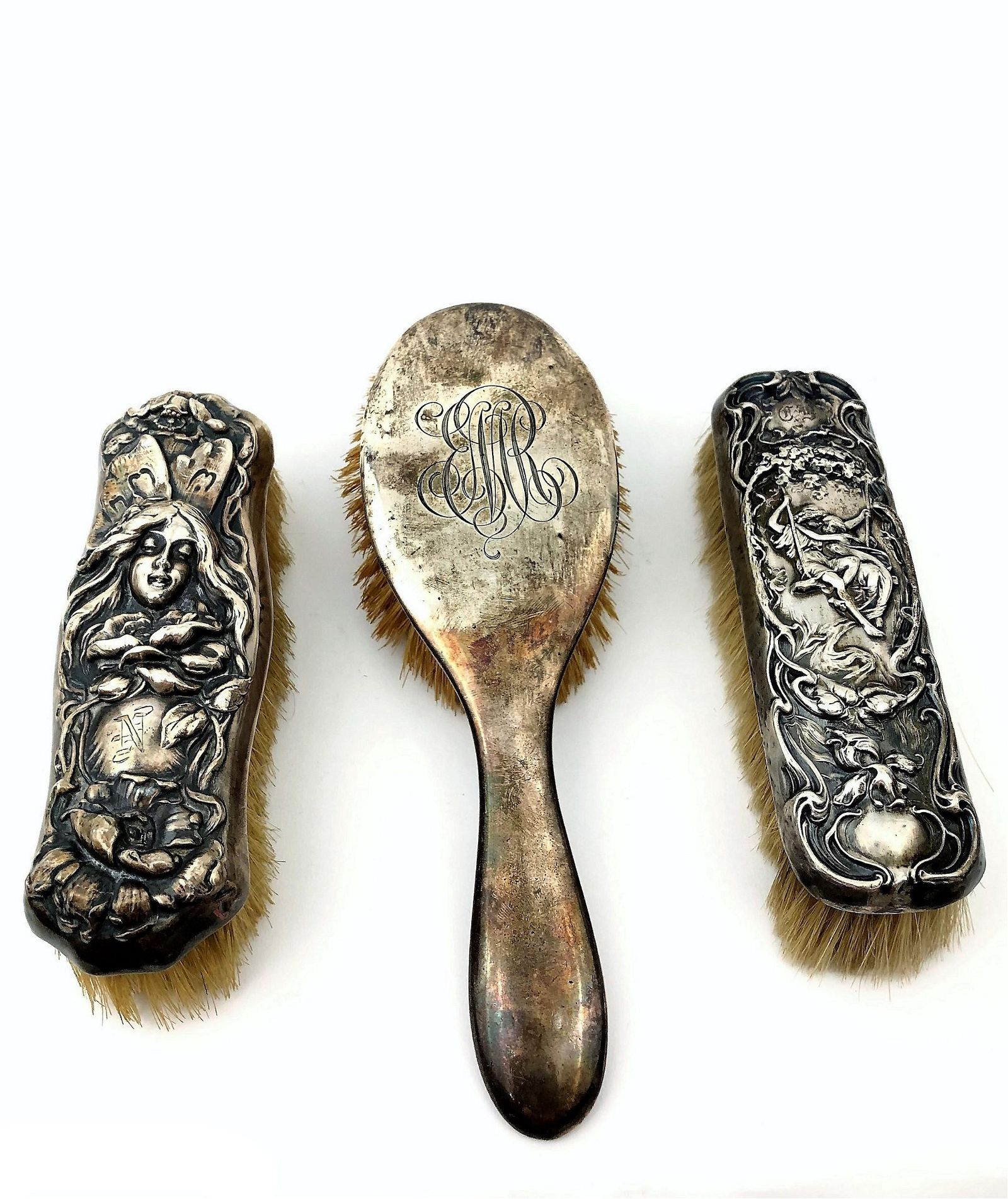 Three Victorian sterling silver brushes