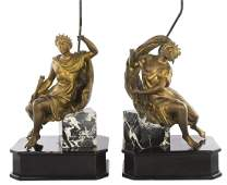 A pair of French gilt bronze and marble table lamps