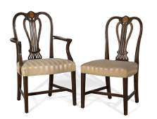 A set of six George III style inlaid carved mahogany