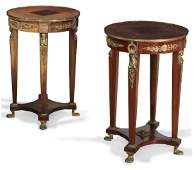 A pair of Empire style gilt metal mounted pedestals