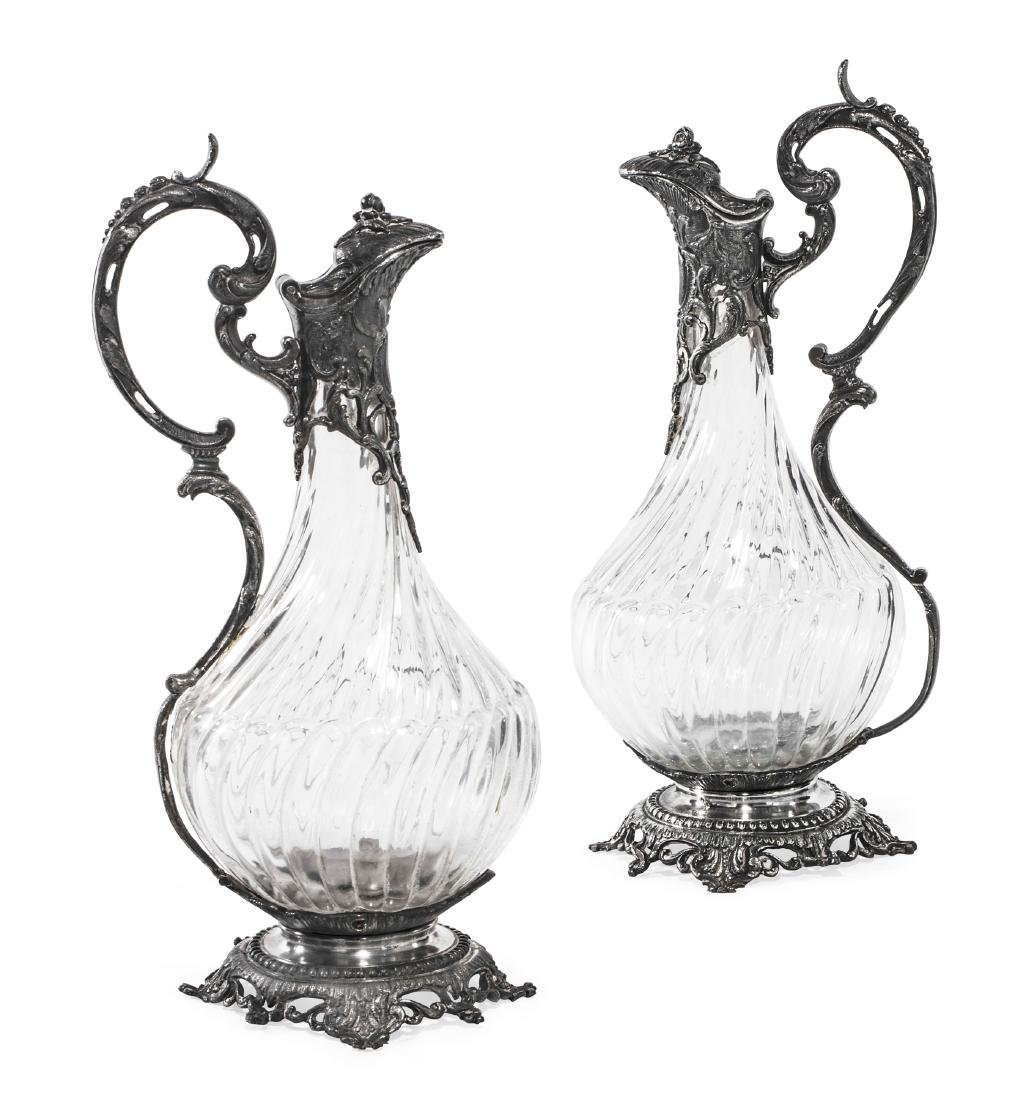 Pair of French silverplate and glass claret jugs
